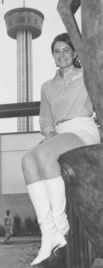 Gale Dowlearn, 19, a press center employee at HemisFair '68, sits in view of the Tower of the Americas on May 9, 1968. Photo: San Antonio Express-News File Photo