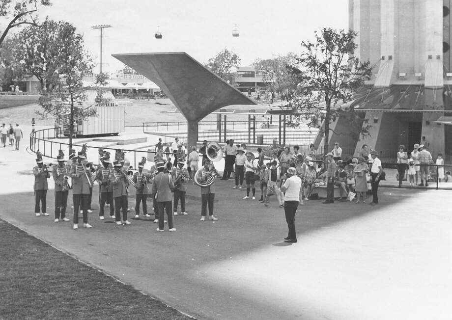The Tower of the Americas offers enough shade for this marching band to practice out of the sun on July 18, 1968, during HemisFair '68. Photo: San Antonio Express-News File Photo