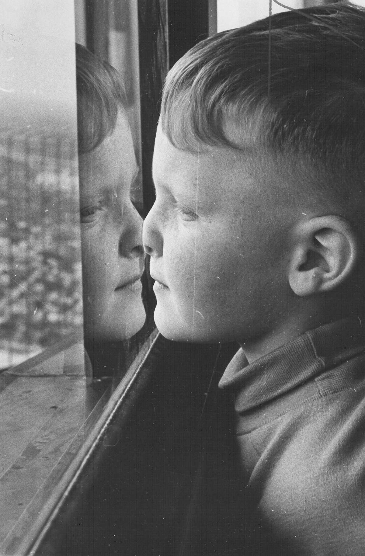 Stephen Sykes of Odessa presses his nose to the glass while taking in the view from the observation deck at the top of the Tower of the Americas during HemisFair '68 on April 11, 1968.