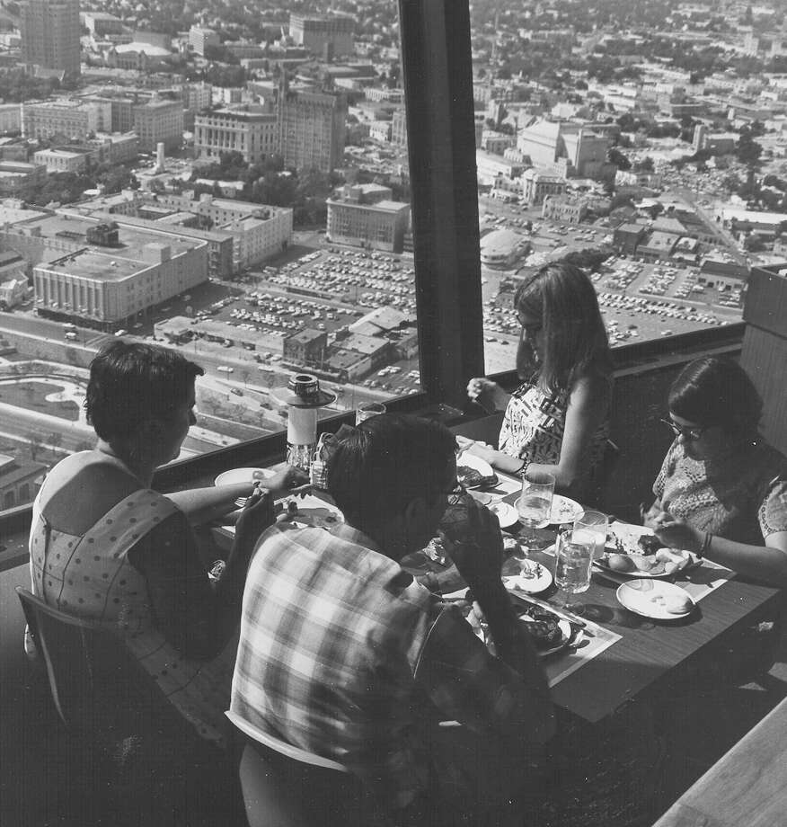 A family enjoys a meal and the view at the restaurant at the top of the Tower of the Americas on June 14, 1968, during HemisFair '68. Photo: San Antonio Express-News File Photo