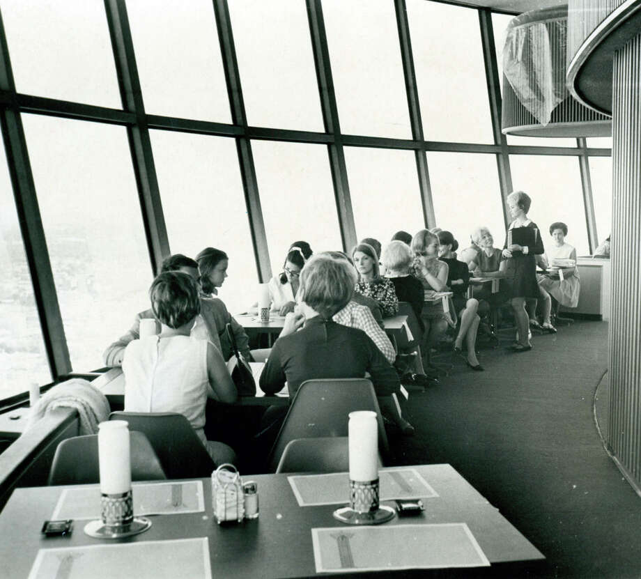 Diners enjoy the restaurant at the top of the Tower of the Americas on April 15, 1968 during HemisFair '68. The revolving restaurant completes a revolution every hour. Photo: San Antonio Express-News File Photo / SAN ANTONIO EXPRESS-NEWS