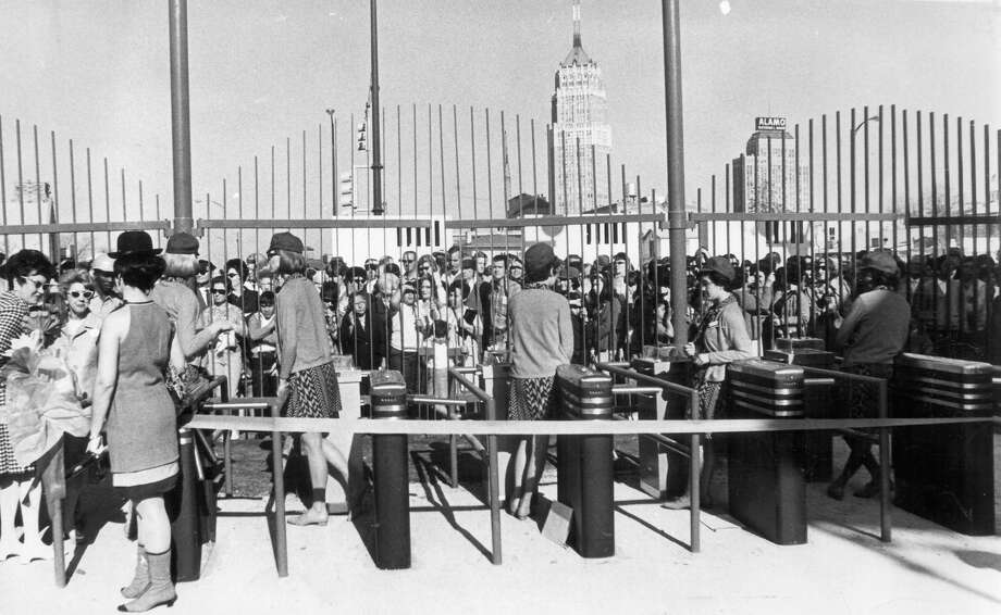 Visitors crowd the gates on Opening Day of HemisFair '68 on April 6. Photo: San Antonio Express-News File Photo / SAN ANTONIO EXPRESS-NEWS