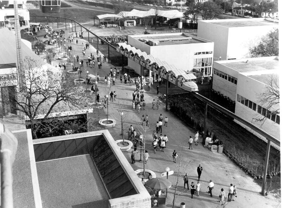 Visitors walk the grounds on the Opening Day of HemisFair '68 on April 6. Photo: San Antonio Express-News File Photo / SAN ANTONIO EXPRESS-NEWS