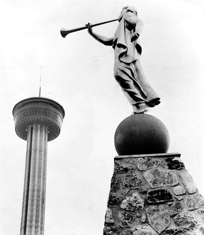 The Tower of the Americas appears to be heralded by the Angel Moroni sculpture, part of the Mormon Pavilion, during HemisFair '68 festivities. Photo: San Antonio Express-News File Photo