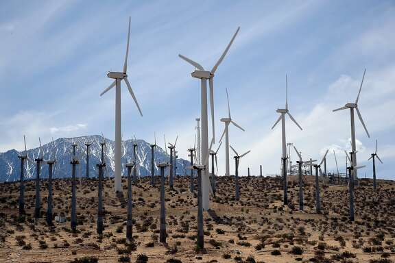 PALM SPRINGS, CA - MARCH 27:  Giant wind turbines are powered by strong winds on March 27, 2013 in Palm Springs, California. According to reports, California continues its lead in green technology and has the lowest GHG emissions per capita, in the Nation. (Photo by Kevork Djansezian/Getty Images)