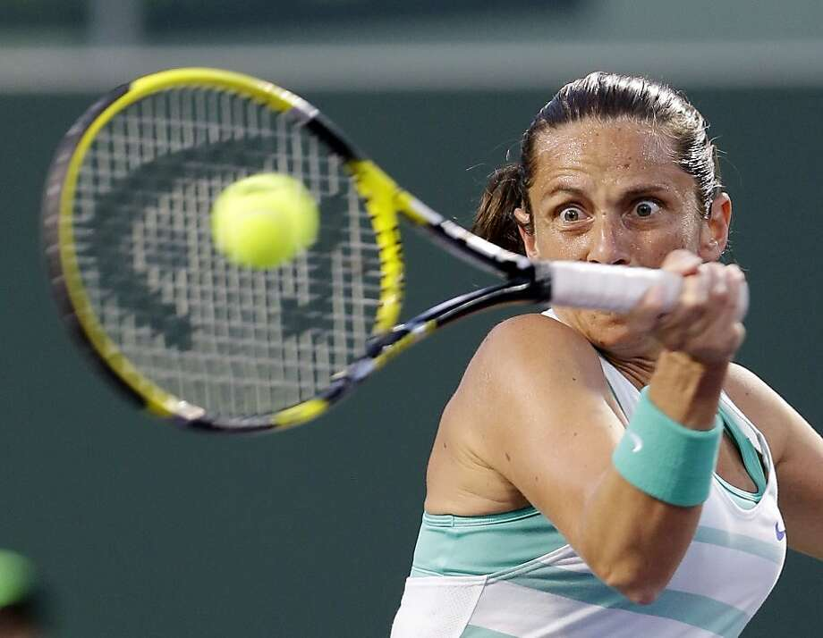 Roberta Vinci of Italy, returns to Jelena Jankovic of Serbia, during the Sony Open tennis tournament, Wednesday, March 27, 2013 in Key Biscayne, Fla. (AP Photo/Wilfredo Lee) Photo: Wilfredo Lee, Associated Press