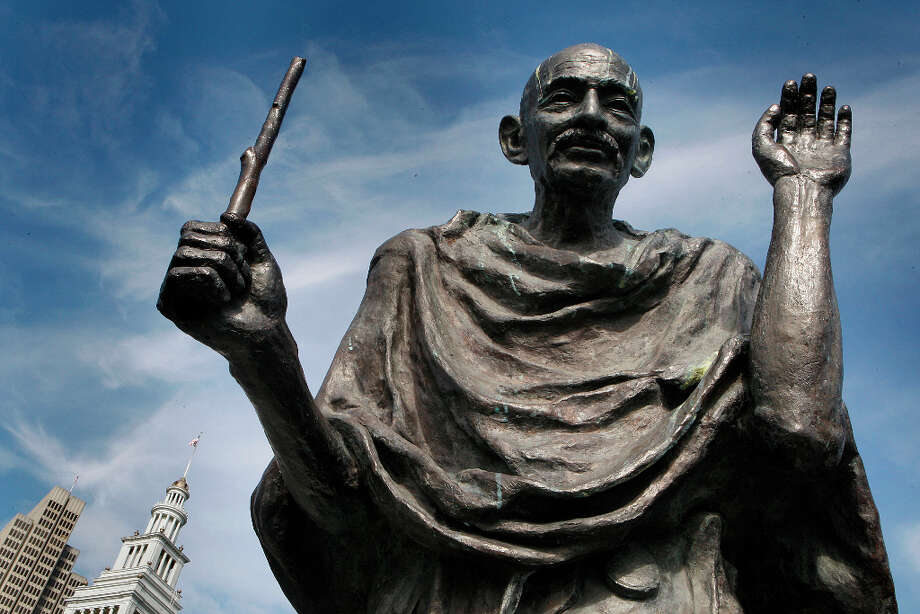 Wingardium leviosa! The bronze statue of Mohandas Gandhi behind the Ferry Building in San Francisco, California, is missing his glasses and the bottom part of his staff, leaving him with just a foot-long bit in his hand. His glasses have also been stolen at least four times within the last 10 years. Photo: Liz Hafalia, The Chronicle / SFC