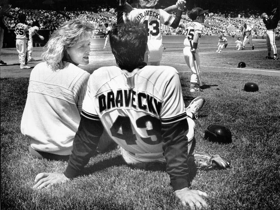 DAVE DRAVECKY (1988): Dravecky is pictured here on August 8, 1989, two days before his incredible comeback after a cancer diagnosis. He seems calm in the photo, lounging with his wife Jan while watching his children play in a Giants family softball game. Photo: Scott Sommerdorf, The Chronicle / ONLINE_YES