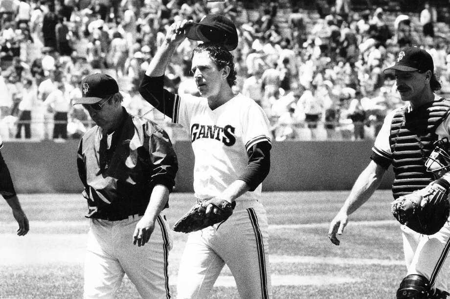 MIKE KRUKOW (1983, 1986 and 1987): Anyone who thinks Krukow's bleeding-Giants-orange gamer talk is a ruse can come look at our photo archives. He seems to me tipping his cap to fans in every other photo. Krukow salutes after a complete game win over Pittsburgh on May 14, 1985. Photo: Jerry Telfer, The Chronicle / ONLINE_YES