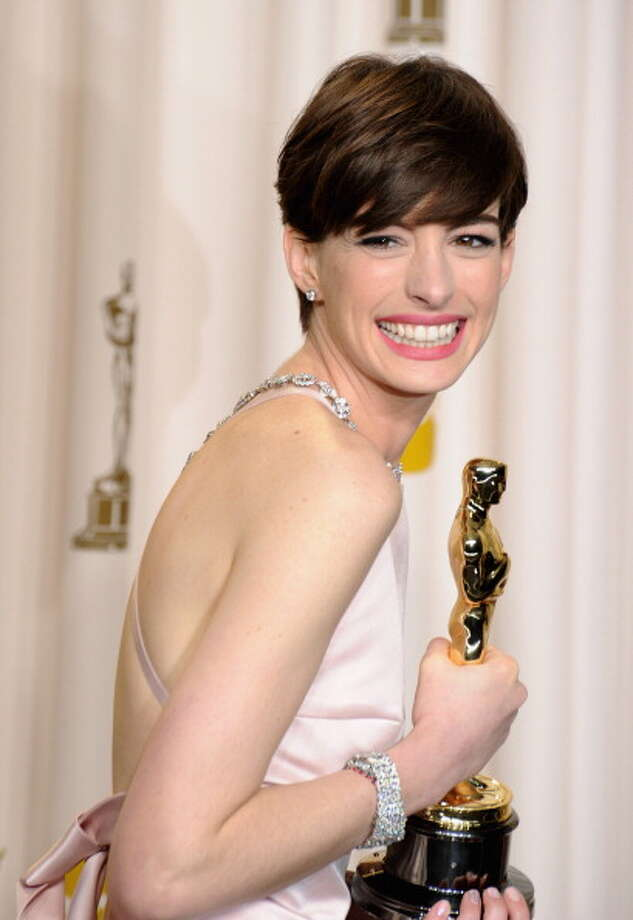 Backstage with her Oscar. Exuding happiness. Photo: Steve Granitz, WireImage / 2013 Steve Granitz