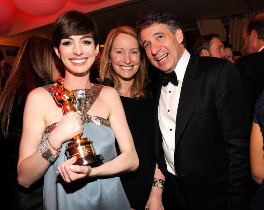 Anne Hathaway at the Vanity Fair party on Oscar night.  She just can't put it down. Photo: Kevin Mazur/VF13, WireImage / 2013 Kevin Mazur/VF13