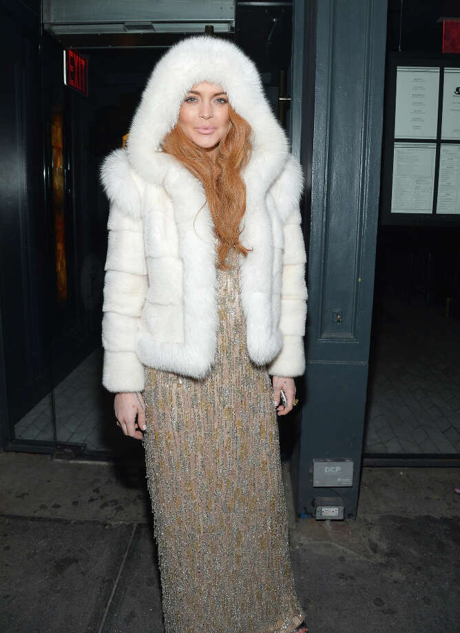 Actress Lindsay Lohan poses outside of the amfAR Gala after party in celebration of Mercedes-Benz Fashion Week at SL on February 6, 2013 in New York City. (suggested by whiterabbit) Photo: Mike Coppola / 2013 Getty Images