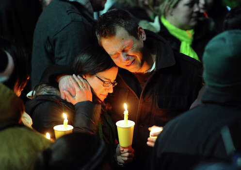 Ted Kowalczuk, of Milford, and his friend Rachel Schiavone, of Norwalk, attend a candlelight vigil held behind Stratfor High School on the Town Hall Green in Stratford, Conn. on Saturday December 15, 2012. Kowalczuk and Schiavone were close friends to Stratford High graduate Vicki Soto, who was killed in yesterday's mass shooting at Sandy Hook Elementary School in Newtown. Soto was a teacher at the school where 27 people died. Photo: Christian Abraham / Connecticut Post