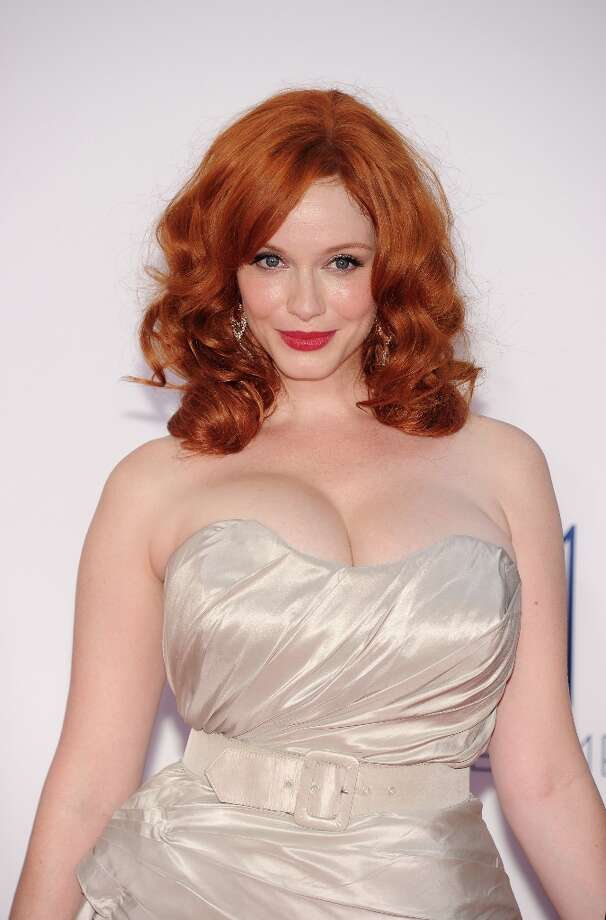 Before Christina Hendricks, 37, played sexy secretary Joan Holloway, she was a model and actress in such shows as 'ER' and 'Firefly.' Here's Hendricks at the 2012 Emmys. Photo: ROBYN BECK, AFP/Getty Images / 2012 AFP