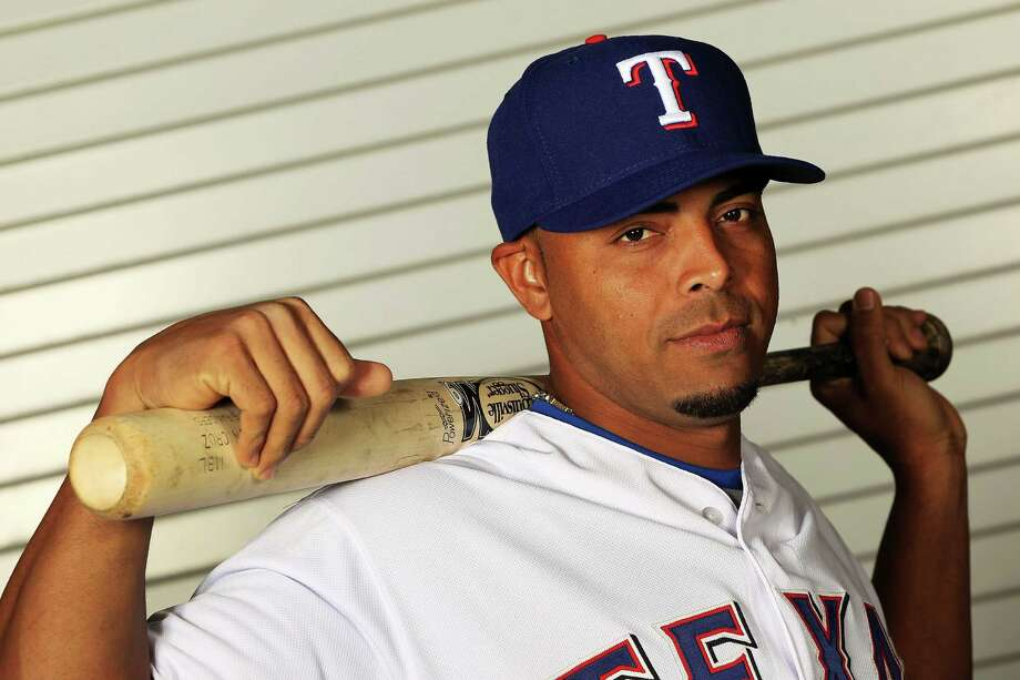 SURPRISE, AZ - FEBRUARY 28:  Nelson Cruz #17 of the Texas Rangers poses during spring training photo day on February 28, 2012 in Surprise, Arizona. Photo: Jamie Squire, Getty Images / 2012 Getty Images