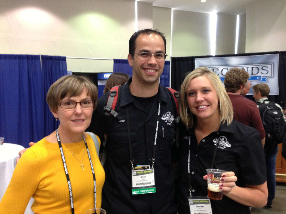 Diane Tannehill, left, and Brian and Jennifer Royo of No Label Brewing in Katy explored the expo.