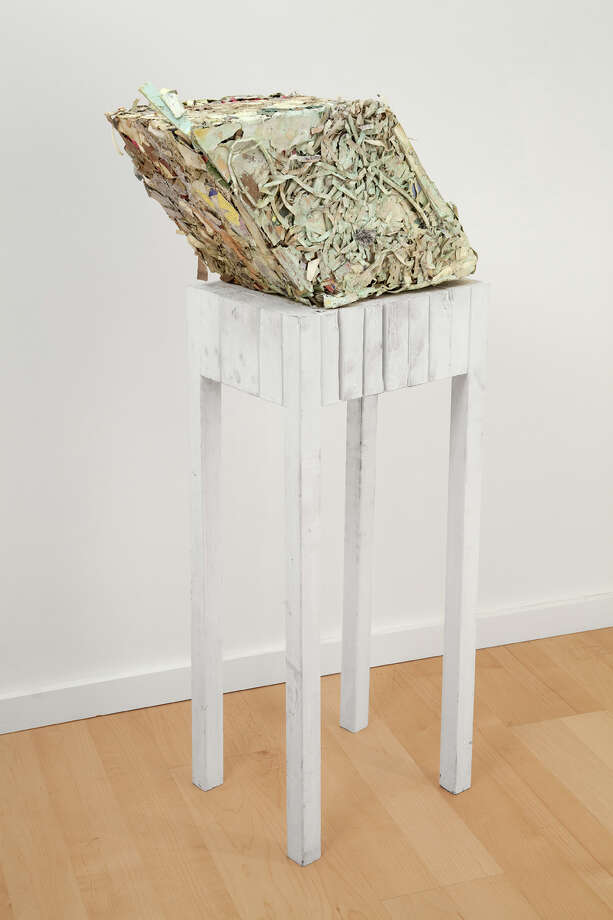 "Terry James Conrad's ""Bale""; paper, paint, plastic on wooden table; 2012 (Courtesy the artist)"