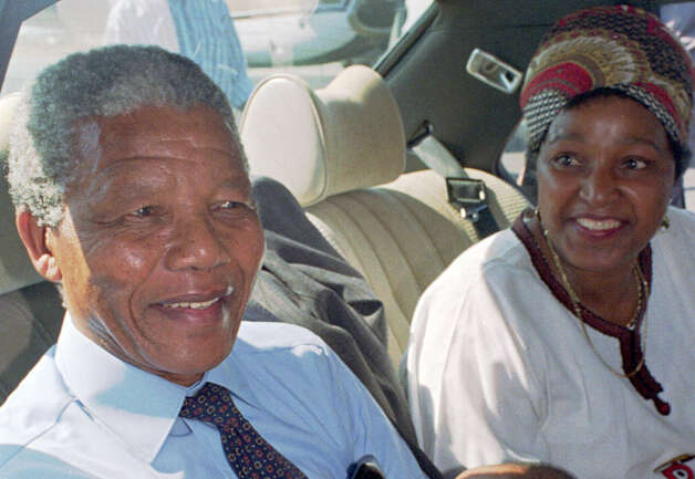 Nelson Mandela, left, and his wife Winnie, right, at Cape Town's airport prior to a flight to Johannesburg in this February 1990 photo, the day after his release from prison. Photo: ADIL BRADLOW, Wire /