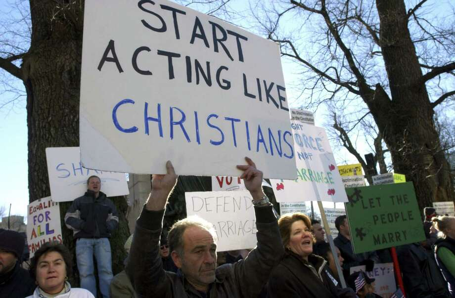 Richard Steinecke, a supporter of same-sex marriage, displays a sign outside the State House in Boston, Mass. Photo: Darren McCollester, Getty Images / 2007 Getty Images