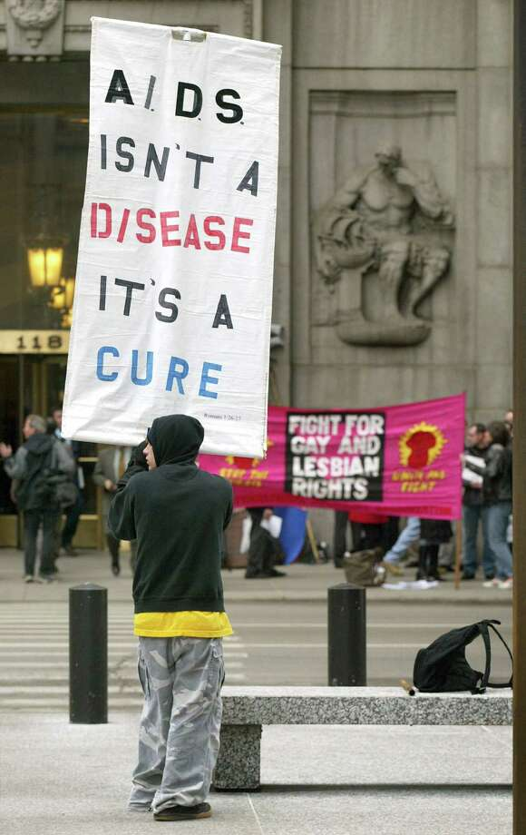 An anti-gay-marriage demonstrator holds a sign across the street from gay-marriage supporters at City Hall in Chicago, Ill. Photo: Tim Boyle, Getty Images / 2004 Getty Images