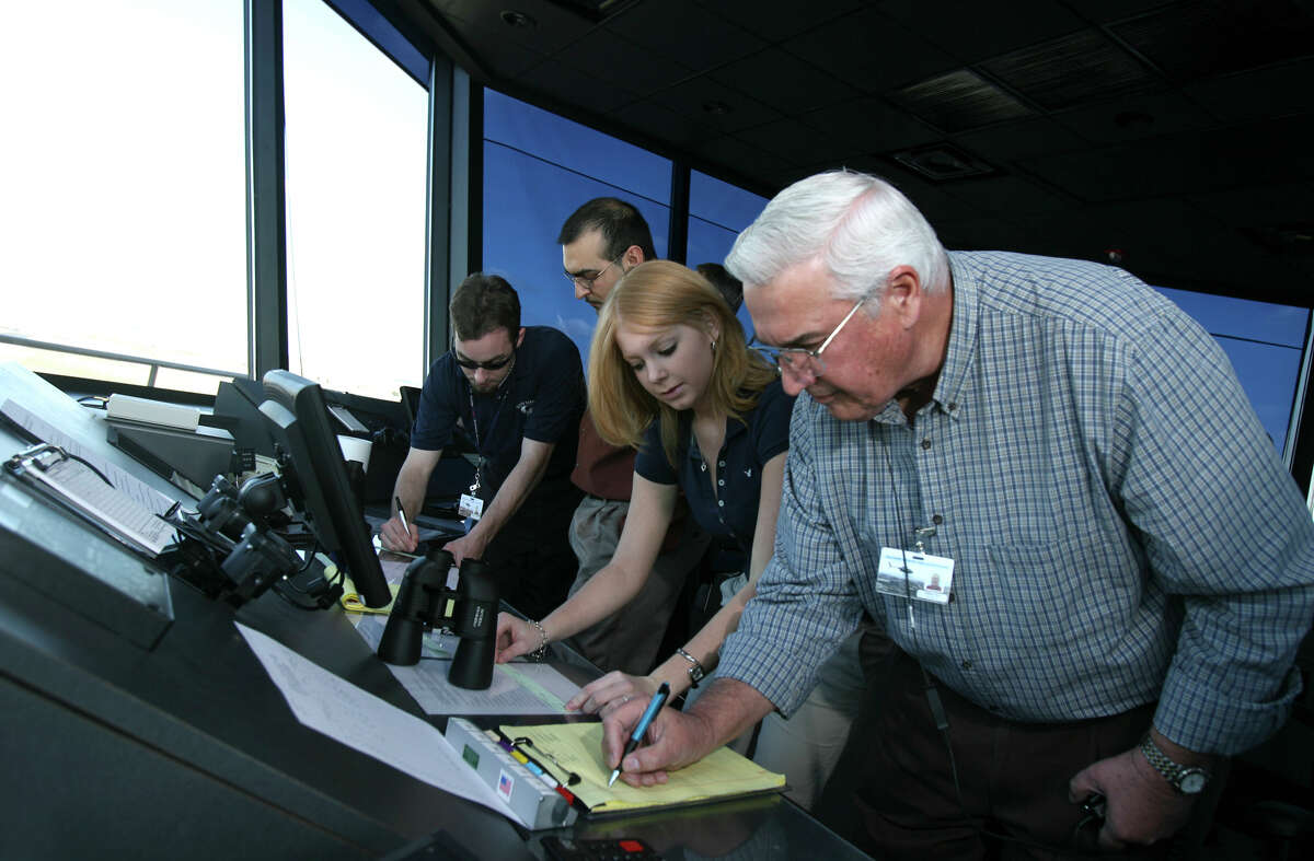(left to right( Dylan Krassensky, Andreas Sanchez, and Crystal Borror (cq) are attending air traffic control school in the tower at the New Braunfels Municipal Airport. William Bose (right) is an instructor. Monday February 5, 2007.