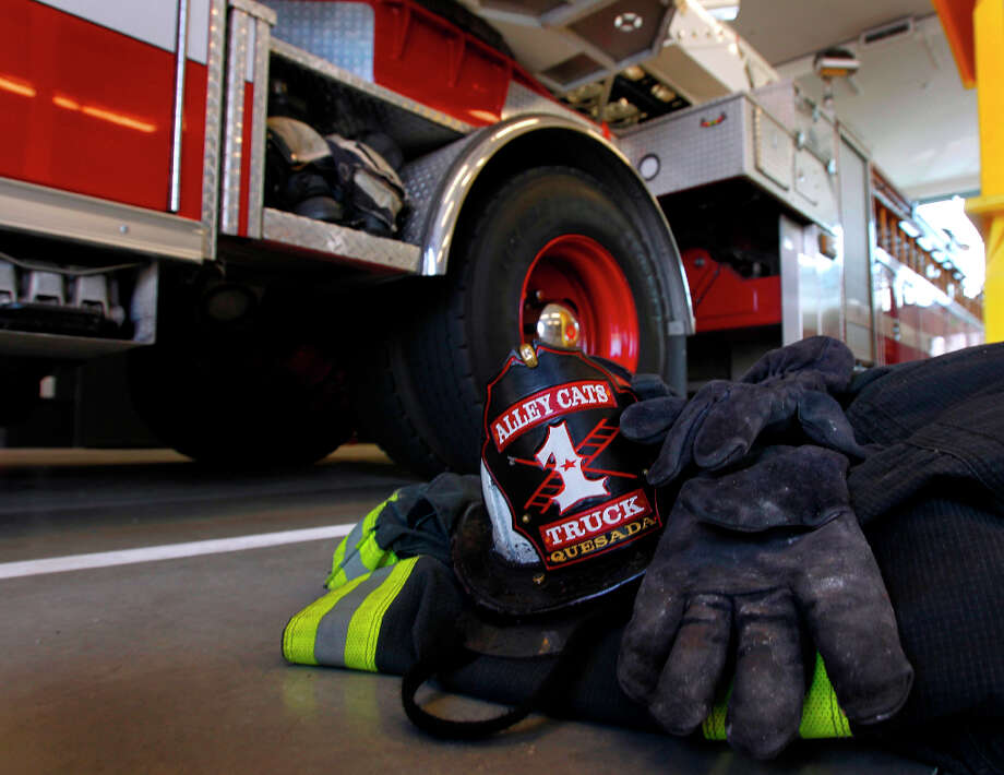 Fire gear is ready to grab at Fire Station No. 1 on Folsom Street. Photo: Paul Chinn, The Chronicle / ONLINE_YES