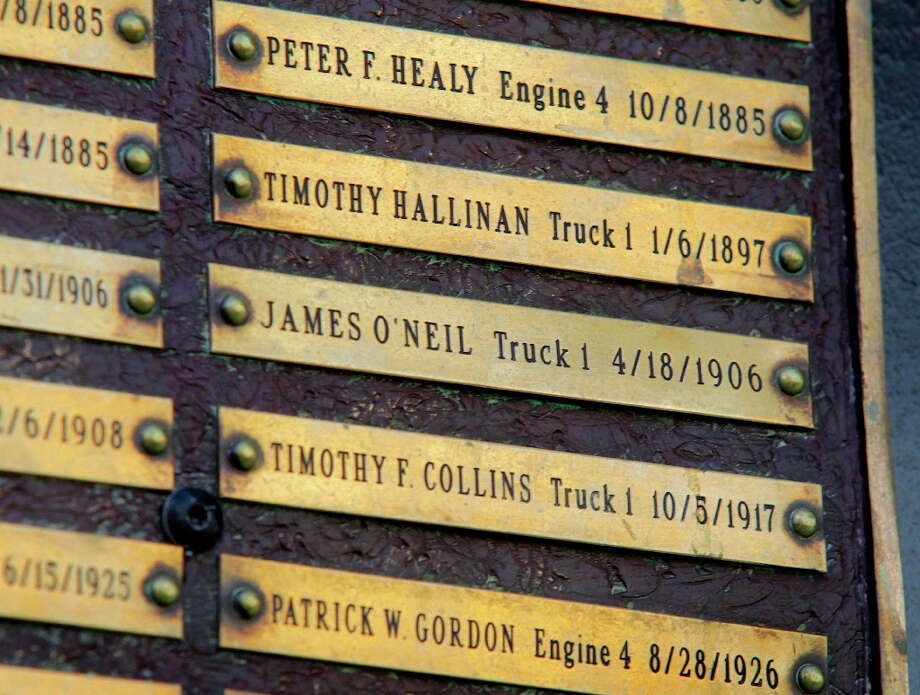 A plaque, memorializing firefighters from the station who died in the line of duty over the years, is mounted in front of Fire Station No. 1 on Folsom Street in San Francisco. Photo: Paul Chinn, The Chronicle / ONLINE_YES