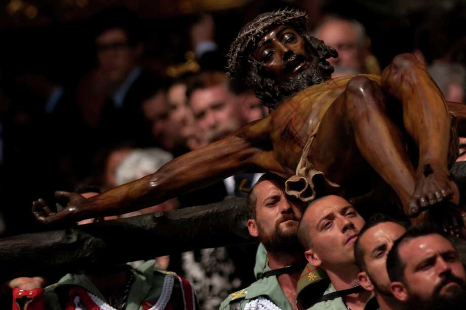 Members of the Spanish Legion carry a statue of the Christ of the Good Death to the Santo Domingo de Guzman church during a Holy Week procession in Malaga, southern Spain, on March 28, 2013. Christian believers around the world mark the Holy Week of Easter in celebration of the crucifixion and resurrection of Jesus Christ. Photo: JORGE GUERRERO, Getty Images / 2013 AFP