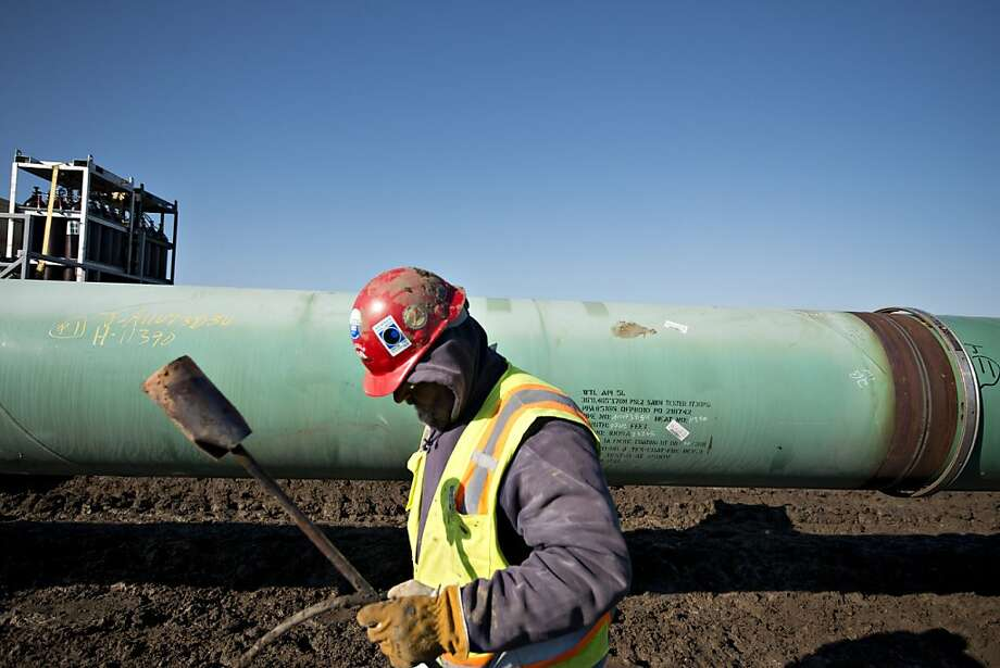 A worker heats a joint on a pipe in Oklahoma that's part of the Keystone pipeline project that runs to Texas from Alberta. Photo: Daniel Acker, Bloomberg
