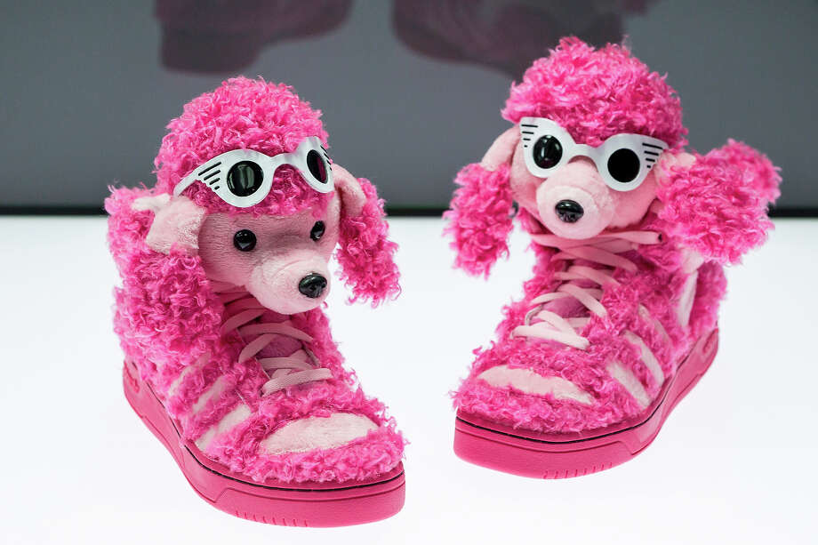 A pair of shoes with the name 'Pink Poodle' designed by Jeremy Scott and adidas at the exhibition. Photo: Joern Haufe, Getty Images / 2013 Getty Images
