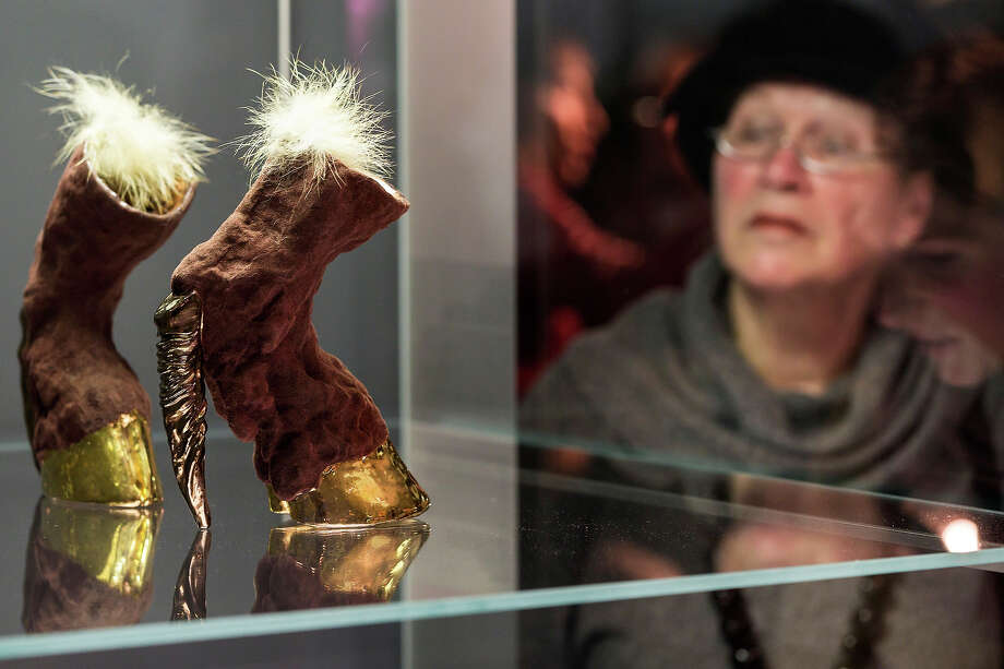 "A visitor looks at a pair of shoes with the name ""Hoof Heels"" designed by Roxanne Jackson at the exhibition. Photo: Joern Haufe, Getty Images / 2013 Getty Images"