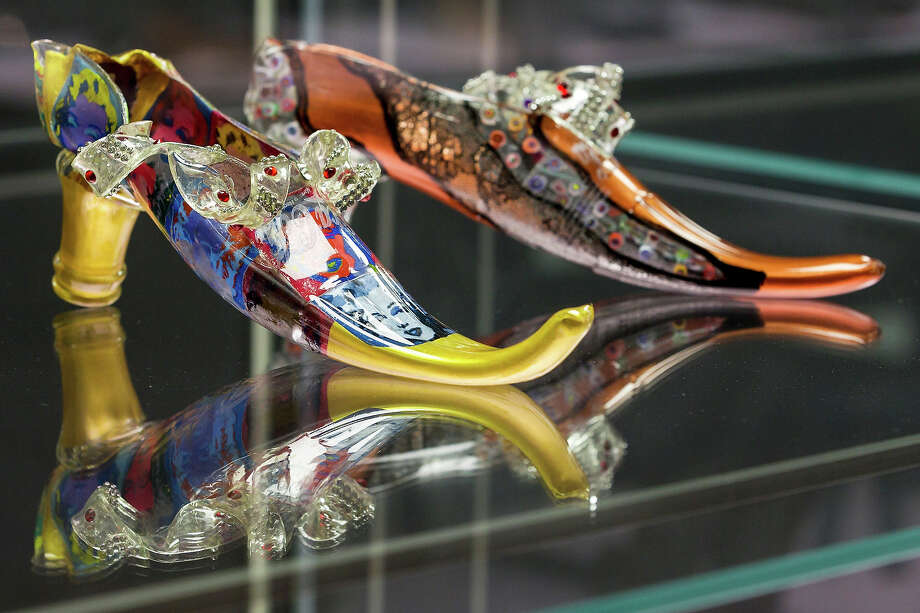 Two shoes with the names 'Ohne Titel' and Marylin and Murrine' designed by Luigi Bona at the exhibition. Photo: Joern Haufe, Getty Images / 2013 Getty Images