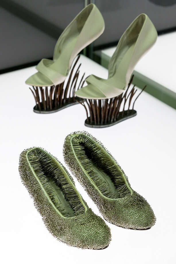 A pair of shoes with the name 'Pinned Shoes' designed by Erwina Ziomskowska and a pair of shoes with the name 'Nails' designed by Emmi Malmstroem and Jesse Sipola at the exhibition. Photo: Joern Haufe, Getty Images / 2013 Getty Images