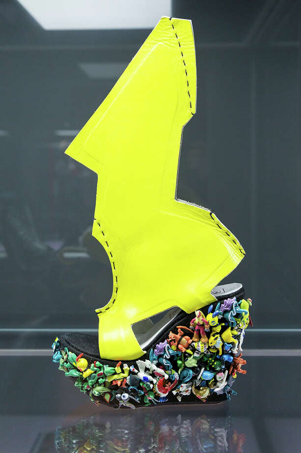 A shoe with the name 'Lady Gaga Shoe' designed for Lady Gaga by Ben Naaem at the exhibition. Photo: Joern Haufe, Getty Images / 2013 Getty Images