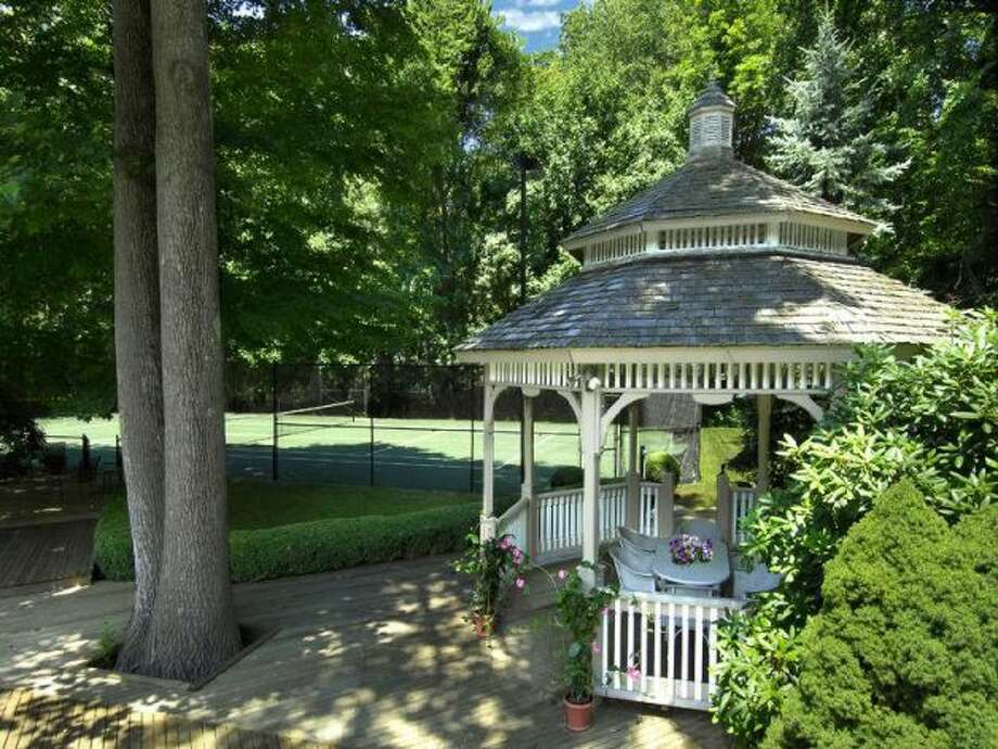 Gazebo with tennis court in the background
