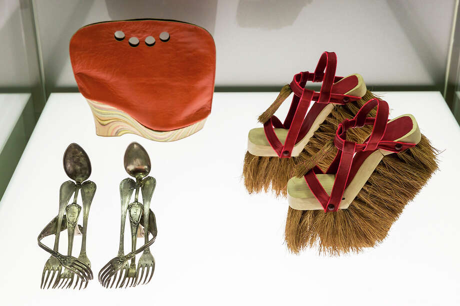 A pair of shoes with the name 'Cutlery' designed by Lauren Johnstone, a shoe with the name 'Shoebag' designed by Astrid Jansen and a pair of shoes 'Brooms' designed by Sol Alonso at the exhibition. Photo: Joern Haufe, Getty Images / 2013 Getty Images