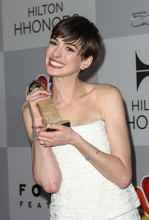 Anne Hathaway very happy to win the Golden Globe in January.