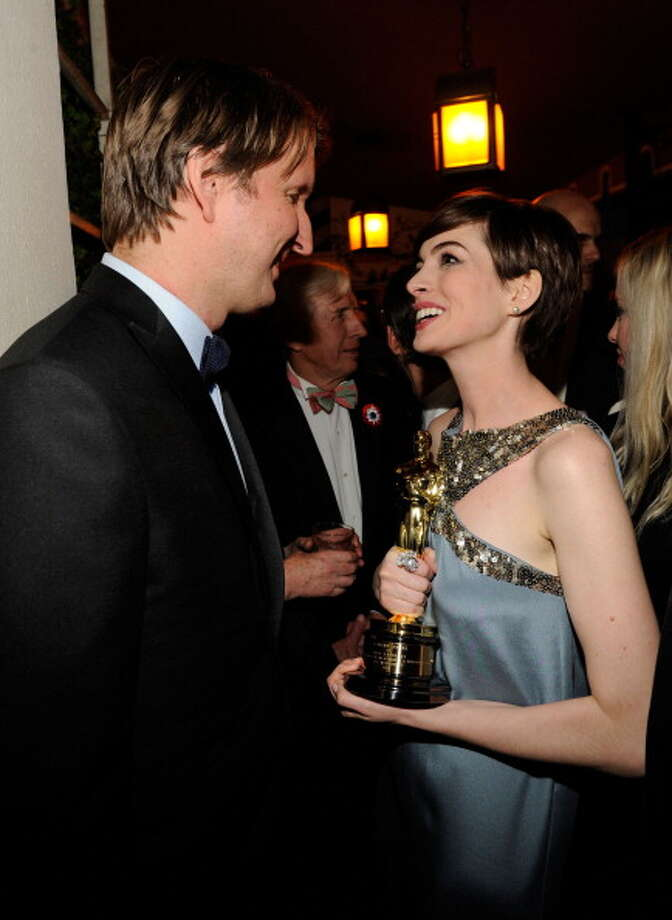 The only bad thing about the Vanity Fair party is that they let in so much riff-raff, you can't put the Oscar down without somebody stealing it.  So you have to carry it around all night and hold it between you and everybody you talk to.  Above, with LES MIS director Tom Hooper. Photo: Kevin Mazur/VF13, WireImage / 2013 Kevin Mazur/VF13