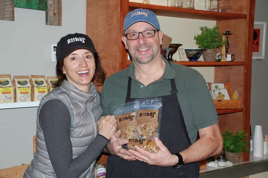 Jarret Liotta / For the Darien News Kathy Monahan of Westport and James Bruno of Darien intend to hit the high note with their new health bar initiative - 8 to the Bar - an organic, gluten-free treat available in several stores throughout the region. Photo: Contributed