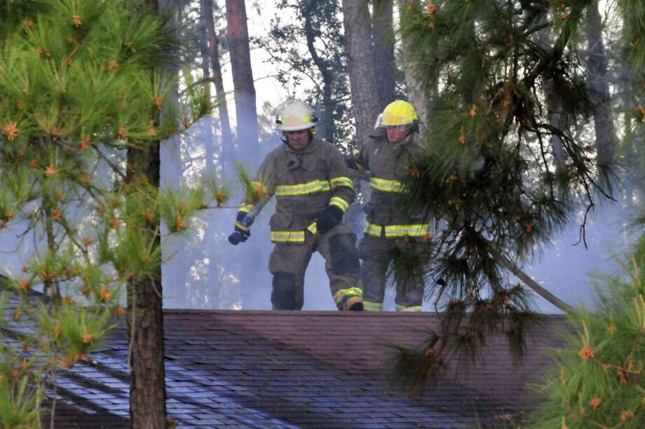 Volunteer firefighters fought a house fire Thursday evening in Kountze. Photo: Cassie Smith