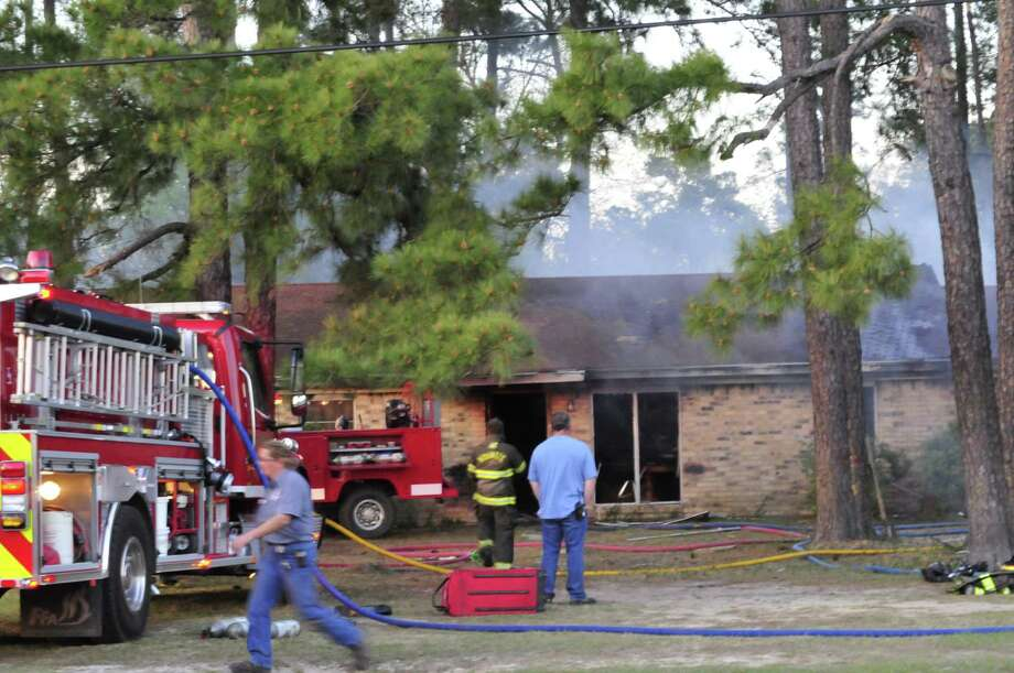 Volunteer firefighters fought a house fire Thursday evening in Kountze. Photo: Cassie Smith