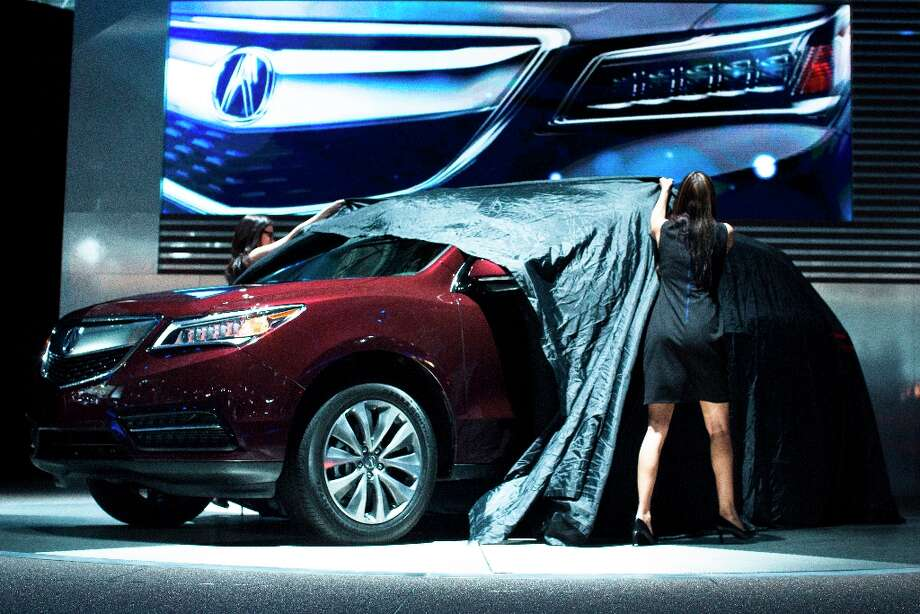 The 2014 Acura MDX is unveiled during the 2013 New York International Auto Show at the Jacob K. Javits Convention Center, Wednesday, March 27, 2013, in New York. (AP Photo/John Minchillo) Photo: John Minchillo, Associated Press / FR170537 AP