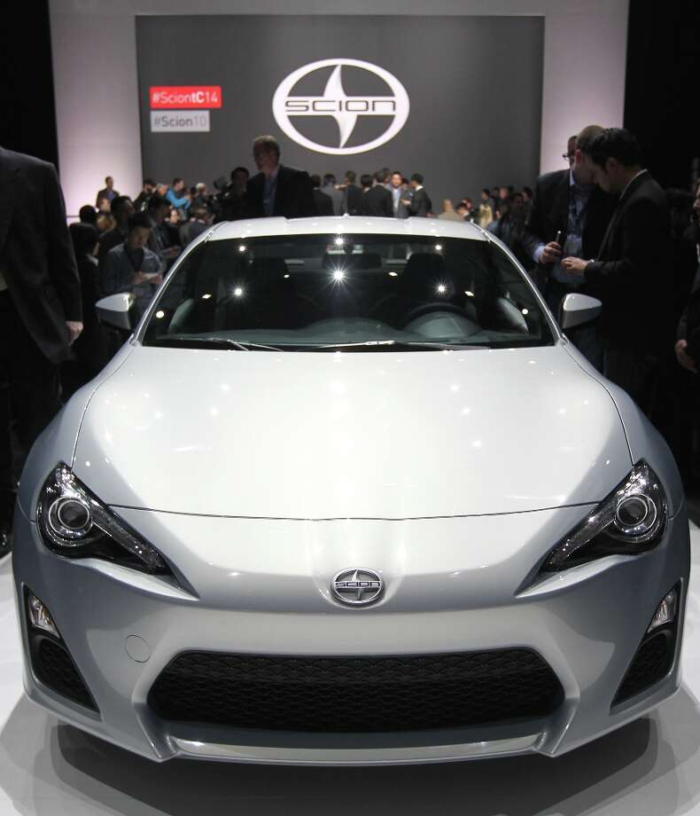 Members of the media view the Toyota Motor Corp. Scion FR-S vehicle after the unveiling during the 2013 New York International Auto Show in New York, U.S., on Thursday, March 28, 2013. The 113th New York International Auto Show, which runs from March 29 to April 7, features 1,000 vehicles as well the latest in tech, safety and innovation. Photographer: Jin Lee/Bloomberg Photo: Jin Lee, Bloomberg / © 2013 Bloomberg Finance LP