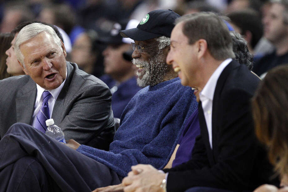 NBA greats Jerry West, left, and Bill Russell, center, sit courtside with Warriors owner Joe Lacob, right, in the first half. Photo: Carlos Avila Gonzalez, The Chronicle / ONLINE_YES