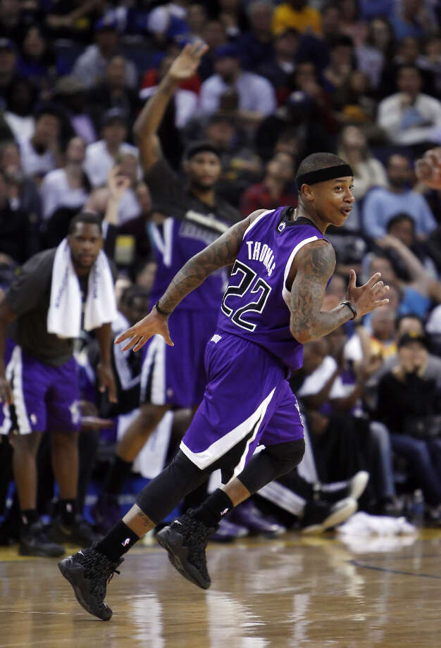 Isaiah Thomas (22) of the Kings reacts to hitting one of his seven three point shots in the second half. Photo: Carlos Avila Gonzalez, The Chronicle / ONLINE_YES