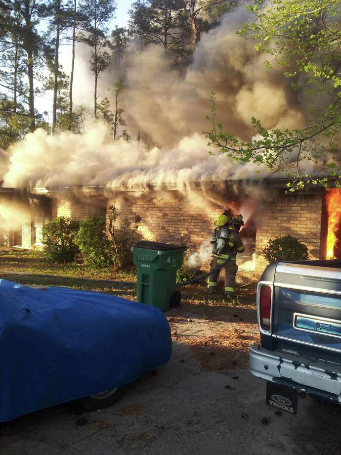 Firefighters fought a house fire Thursday evening in Kountze. Photo: Handout - Suzanne Stoeppleman