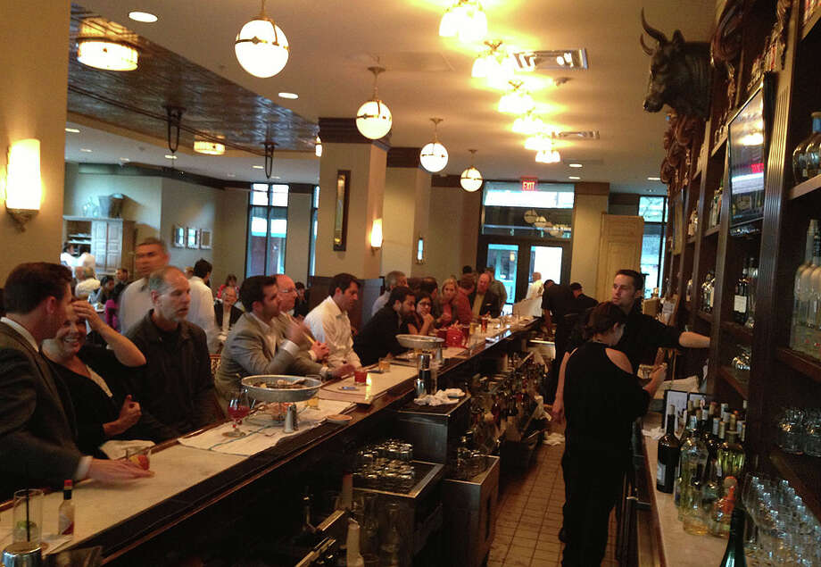 The bar gets packed during Lüke's happy hour, especially on Tuesday nights.
