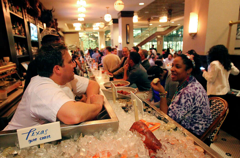 Amy Batiste (right) chats with Lüke chef John Russ. Photo: Kin Man Hui, San Antonio Express-News / © 2012 San Antonio Express-News