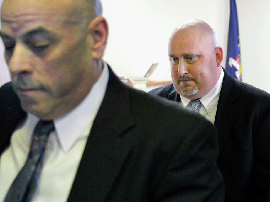Brian Lutz, at right, follows his attorney David Brickman during a break in his hearing in Menands village court  Thursday March 28, 2013.  (John Carl D'Annibale / Times Union) Photo: John Carl D'Annibale / 00021775A