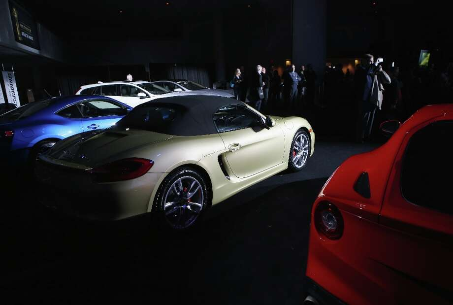 A Porsche Boxster/Cayman (C) is displayed with other cars after being named the 2013 World Performance Car of the Year at the New York Auto Show. It was the second consecutive year that Porsche has won the prestigious title and the third time overall. Photo: John Moore, Getty Images / 2013 Getty Images